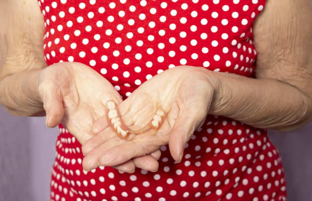 Lady Holding Partial Denture